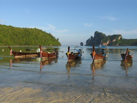Longtail on the beach at Phi Phi Don, Thailand photo