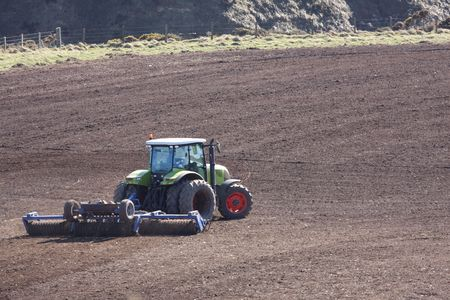 ploughing: Ploughing the field with Green Tractor, Scotland
