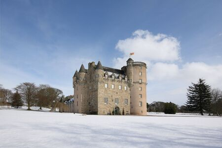 battlements: Castle Fraser in the snow, Aberdeenshire, Scotland Stock Photo