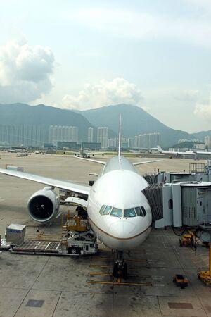 Aeroplane on the stand at Hong Kong Airport photo