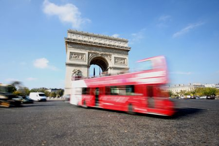 triomphe: Moving traffic at the Arc de Triomphe, Paris, France Stock Photo