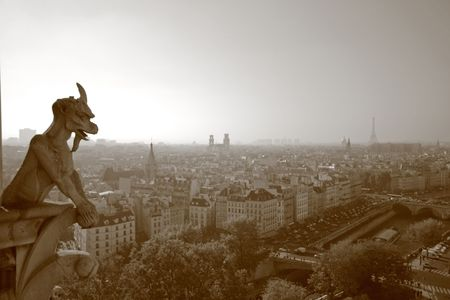 The Gargoyles of Notre Dame looking out over Paris - sepia