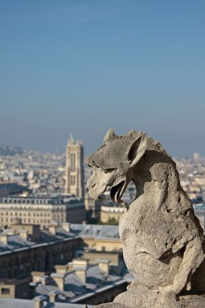 gargoyles: The Gargoyles of Notre Dame looking out over Paris Stock Photo
