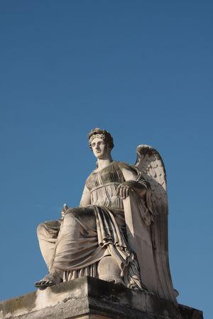 carrousel: Angel statue at the Arc de Triomphe du Carrousel, Paris Stock Photo