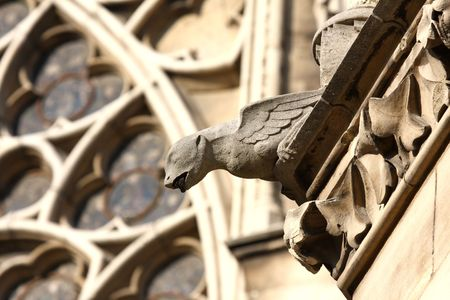gargoyles: The Gargoyles in front of the Rose Stained Glass window at Notre Dame Cathedral, Paris Stock Photo