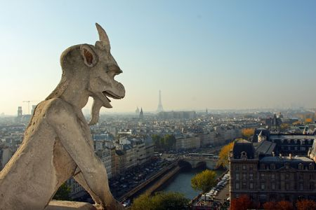 The Gargoyles of Notre Dame looking out over Paris Stock Photo - 3784614