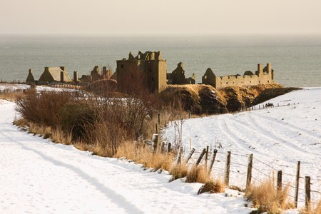 dunnottar castle: Dunnottar Castle with snow on the ground, Scotland Stock Photo