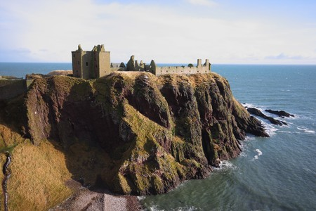 formidable: Dunnottar Castle with snow on the ground, Scotland Stock Photo