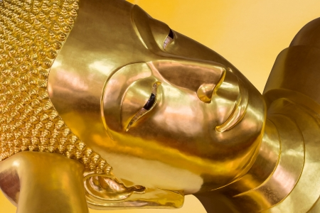 Reclining Buddha Face in Phra Prathom Jedi temple, Nakhon Prathom, Thailand  photo