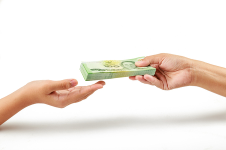 Closeup hands giving money on white background. Person hand giving money to other hand Stock Photo
