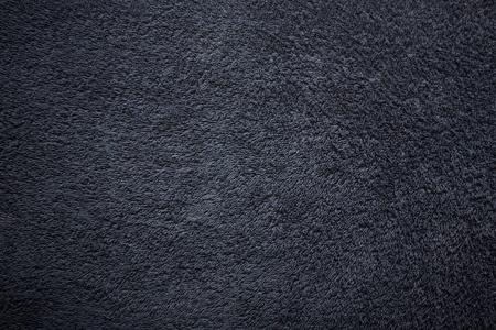 navy blue background:  Black soft towel surface, bath towel texture background