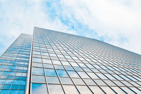 property management: abstract glass skyscraper. Glass wall of office buildings. modern glass silhouettes. Modern office.  Stock Photo