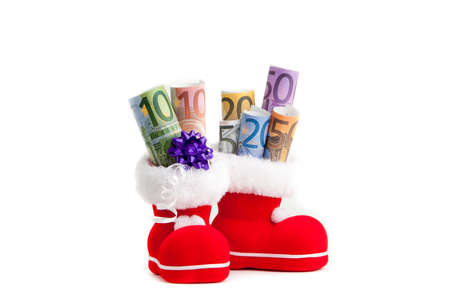 unexpectedness: Euro in boot of Santa Claus on white background