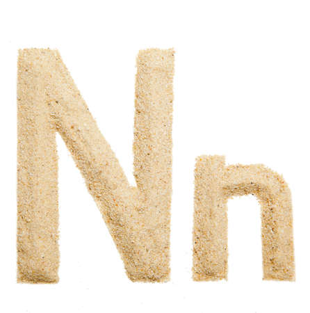 sand alphabet isolated photo