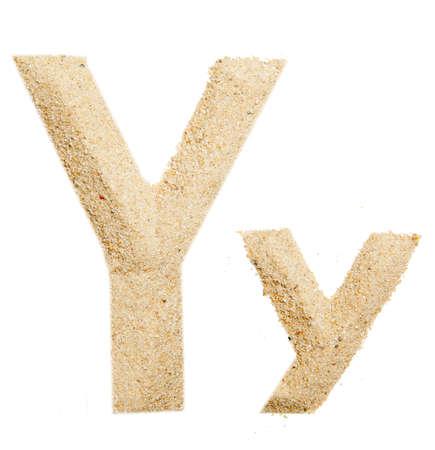 sand alphabet isolated photo