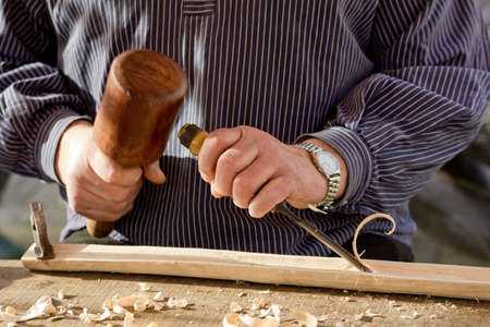 wood carving: Work Of Artist. Stock Photo