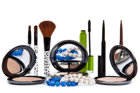 Various cosmetics isolated over white. Makeup products photo