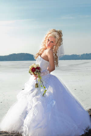 Beautiful bride in the winter forest  Beautiful blonde  photo