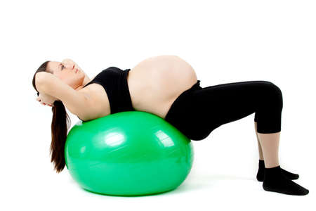 Pregnant woman excercises with gymnastic ball. photo