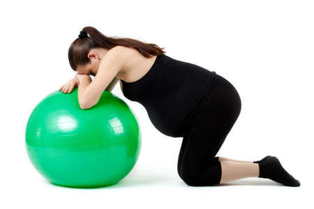 Pregnant woman excercises with gymnastic ball. Stock Photo - 12836368