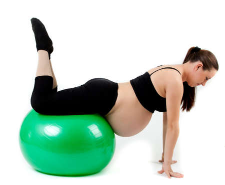 Pregnant woman excercises with gymnastic ball. Stock Photo - 12836325