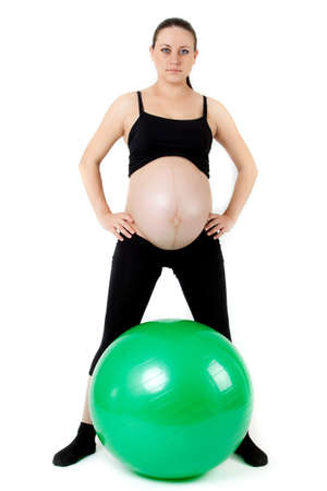 Pregnant woman excercises with gymnastic ball. Stock Photo - 12836312