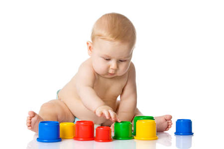 Baby playing with cup toys. Isolated on white background photo