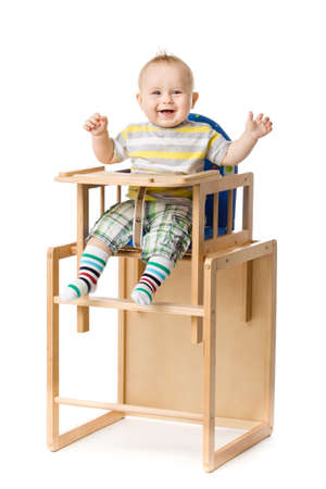 highchair: Baby sitting in highchair