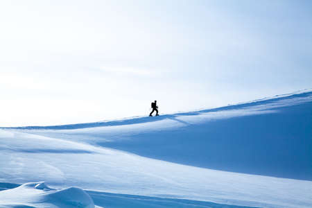 Hiker in winter mountains  Winter landscape  winter mountains landscape  Beautiful winter photo