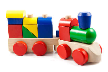Colorful wooden toy train isolated on white background photo