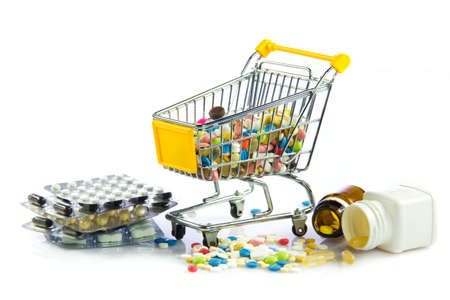 shopping cart full of pills isolated on white  Shopping cart with medicine pills