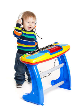 dj boy: little boy and the keyboard on white background. funny boy baby. young DJ Stock Photo