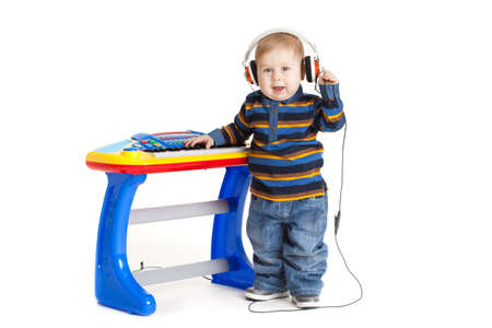 dj boy: little boy and the keyboard on white background  funny boy baby  young DJ Stock Photo