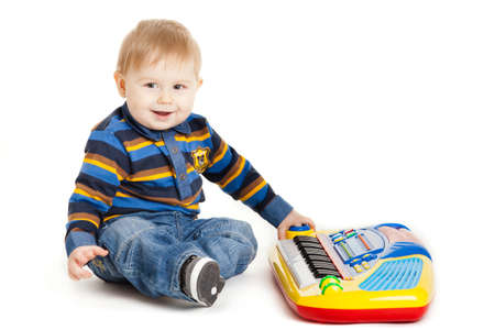 little boy and the keyboard on white background  funny boy baby  young DJ photo