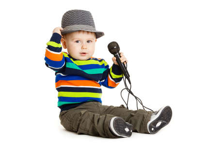 Portrait of happy beautiful little boy isolated on white background  Baby and a microphone  photo