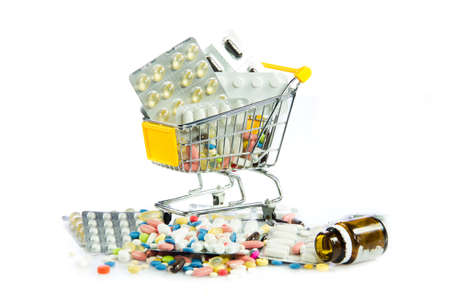 shopping cart full of pills isolated on white. Shopping cart with medicine pills photo