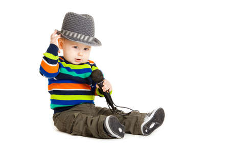 Portrait of happy beautiful little boy isolated on white background. Baby and a microphone. photo