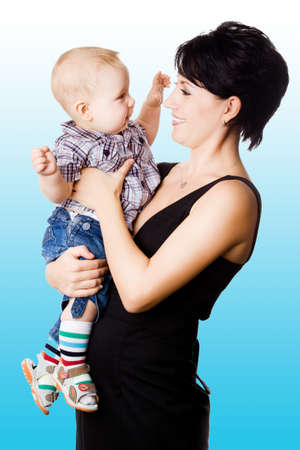 Beautiful happy mather with attractive baby boy o  Portrait of  baby and his mother  photo