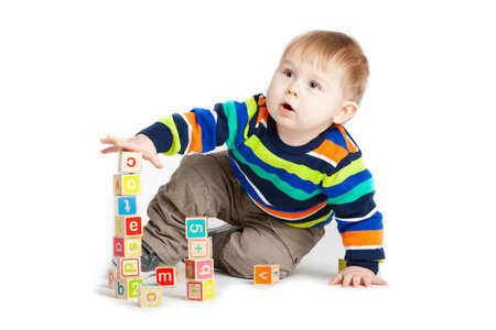baby playing with wooden toy cubes with letters. Wooden alphabet blocks. photo
