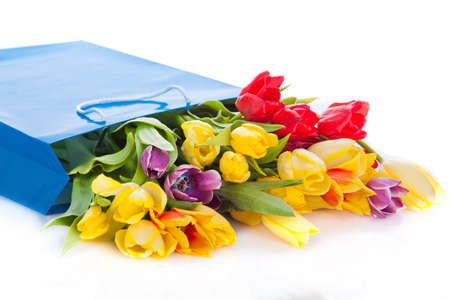 bouquet of tulip flowers in the blue bag photo