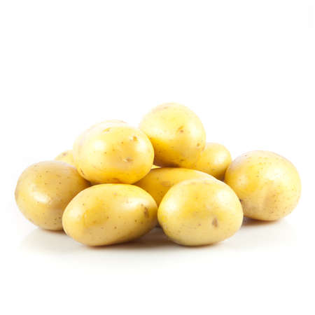 Fresh potatoes on a white background. photo