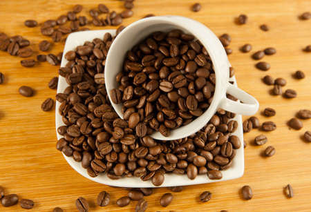 winnower: coffee beans. coffee beans in a cup.