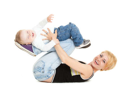Beautiful happy mother with attractive baby boy on white photo