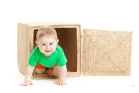 conform: little boy inside a box on a white background