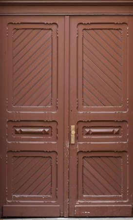 Wooden front door of a home. Old Wooden Door. photo