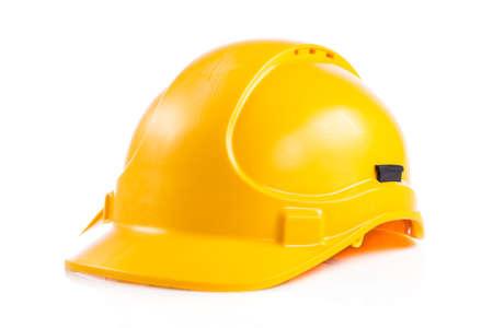 白い背景の上の黄色の安全ヘルメット。 ヘルメット白で隔離 写真素材