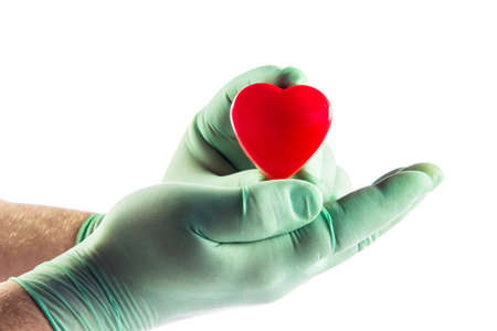 Medical doctor holding heart. Health insurance concept photo