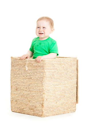 little boy inside a box on a white background photo