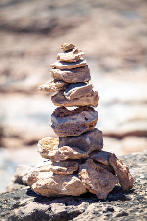 Stones balance, pebbles stack over blue sea photo
