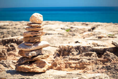 Stones balance, pebbles stack over blue sea Stock Photo - 21536562